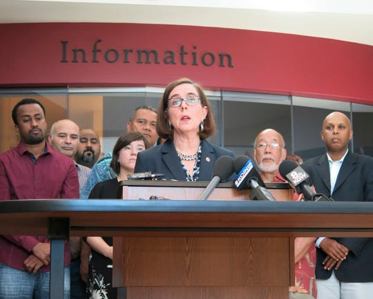Oregon Gov. Kate Brown speaks at a news conference after a man fatally stabbed two men Friday on a light-rail train when they tried to stop him from yelling anti-Muslim slurs at two young women, one of whom was wearing a hijab in Portland, Ore., May 27, 2017.