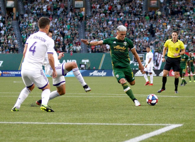 Portland Timbers' Brian Fernandez attempts a shot on goal as Orlando City players, including Will Johnson (4), defend during an MLS soccer match Thursday, July 18, 2019, in Portland, Ore.