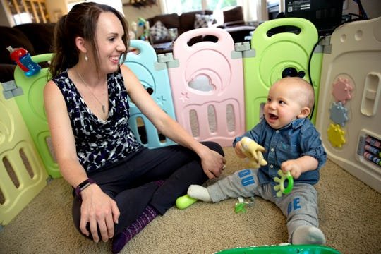 Angela Tipton and her 11-month-year-old son, Ares, play at their home in west Salem on July 17, 2019.