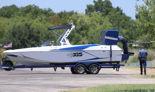 San Angelo police officers investigate a boat involved in an accident on Lake Nasworthy that occurred at approximately 12:54 p.m. Friday, July 19, 2019.