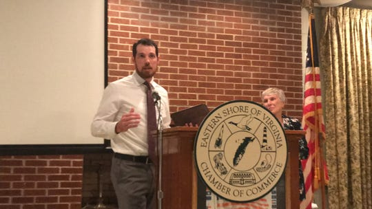 Josh Chapman of Black Narrows Brewing Co. accepts the Young Entrepreneur of the Year Award as Terris Kennedy, who nominated him, looks on, during the Eastern Shore of Virginia Chamber of Commerce annual meeting in Accomac, Virginia on Thursday, July 18, 2019.