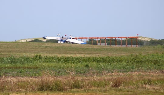 A plane overturned upon landing at the Ocean City Municipal Airport on Friday, July 19, according to witnesses.