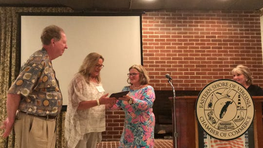 Bill and Fran Lytle, left, accept the Outstanding Citizens of the Year Award from Board Chairwoman Jeanette Edwards during the Eastern Shore of Virginia Chamber of Commerce annual meeting in Accomac, Virginia on Thursday, July 18, 2019.