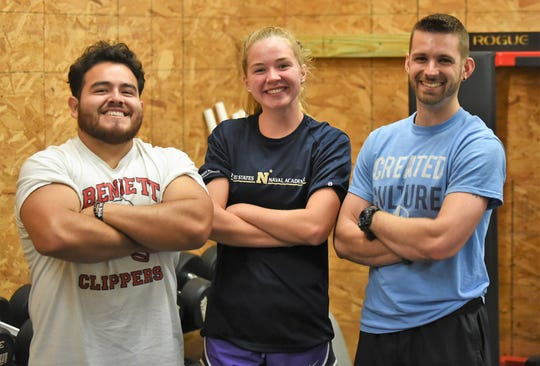 YMCA swimmer Cameron Horner poses with Ricardo Bravo (left) and Cody Revel (right) who are coaches at The Athlete Academy.