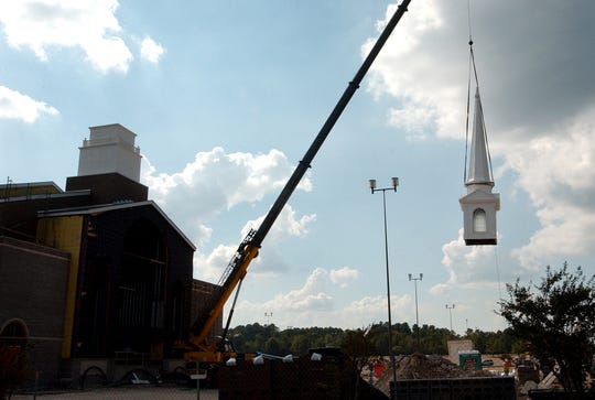 The steeple is placed atop the new location of Summer Grove Baptist Church at the old South Park Mall.