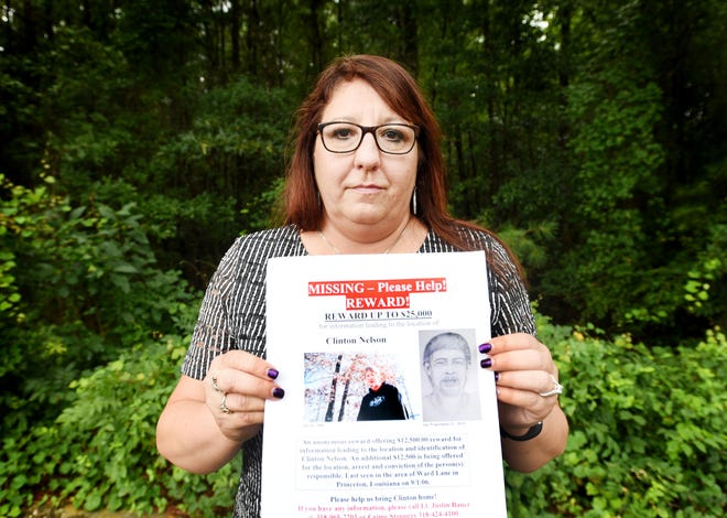 Carolyn Teigen holds a missing person flyer for her son, Clinton Nelson, who vanished from a friend's home in Princeton 13 years ago.