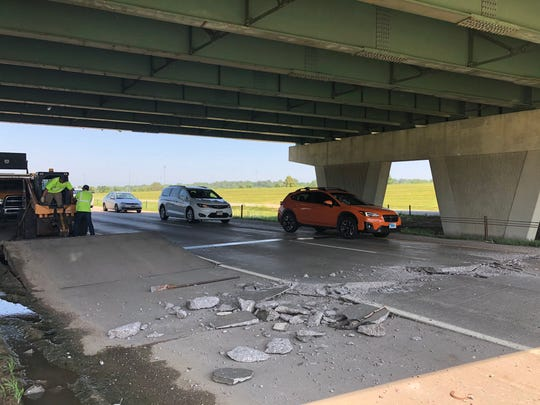 Vehicles drive over a buckled road on Interstate 229 under the Western Avenue bridge on Friday in Sioux Falls.