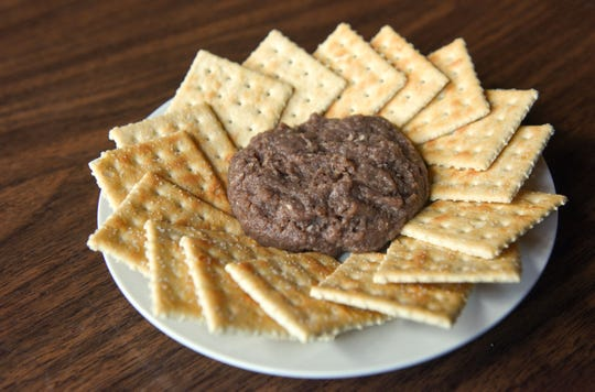 Tiger meat: Raw hamburger seasoned and cured, eaten like a dip with crackers. Commonly referred to as