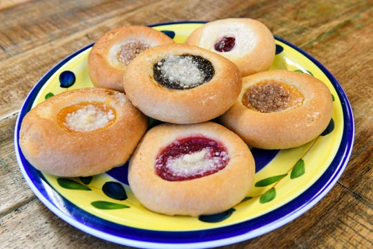 Kolache: A Czech puff pastry with fruit pocketed in the middle, such as poppy seeds, prunes, lemons, peaches or cherries; can be topped with streusel or frosting.