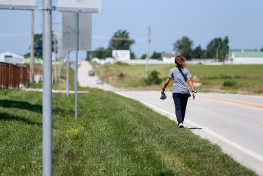 Rebecca McCrea, from western Pennsylvania, walks through Bolivar, Mo. during her walk across the United States for the Best Friends Animal Society on Friday, July 19, 2019.  McCrea has walked more than 1,000 miles across six states since she started in mid-May.