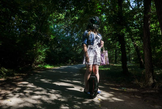 Nylah Rogers rides her electric unicycle down the Greenway Trail in Sequiota Park on Friday, July, 19, 2019 in Springfield, Mo.