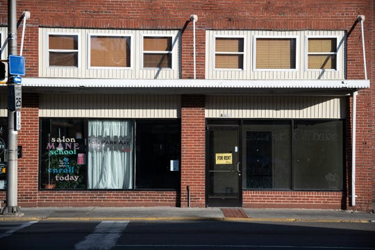 "A ""For Rent"" sign hangs in a doorway of a vacant storefront in downtown Norton, Va."