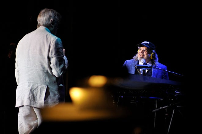 """From left to right: Garrison Keillor and Richard Dworsky performing """"A Prairie Home Companion"""" with a live audience"""