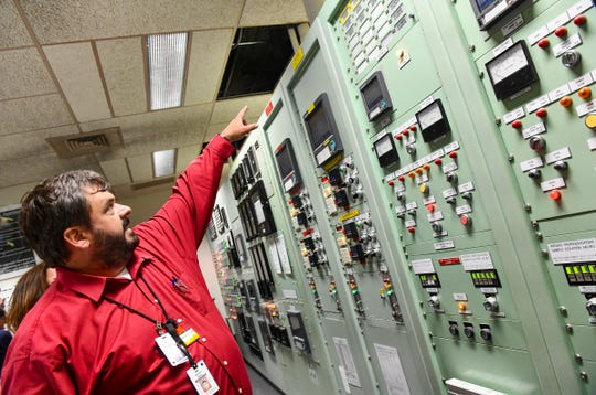 Plant manager Jason Kindred talks about equipment installed in the control room Thursday, July 18, 2019, at Xcel Energy's Monticello Nuclear Generating Plant.