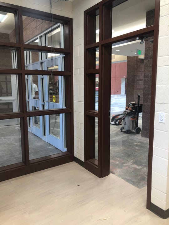 A look at the locked security doors to the left and the entrance through the office to the right where visitors will have to go to access the building at Washington Fields Intermediate School.