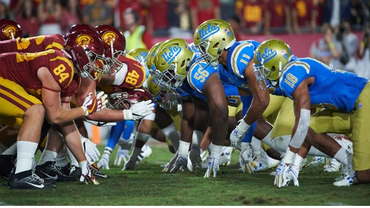 Greg Rogers (56) lines up against USC during the 2017 season.