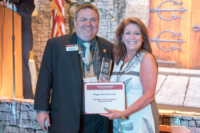 Past District 84 Director, DTM Mike McLean presents Award and Certificate to Past Division Director Maggie Beth McGrotha in May 2019.