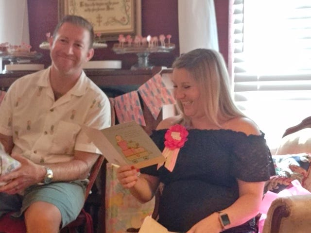 Cory and Kady receiving gifts for Carter,
