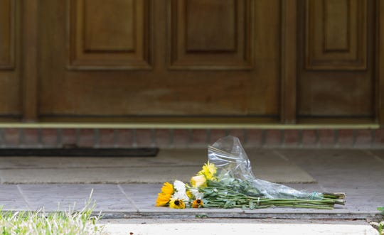 Flowers lay in front of Dan Markel's house on Tuesday, July 22, 2014 in Tallahassee, Fla.  According to the Tallahassee Police Department, Markel was found at his home with a gunshot to the head around 11 a.m on Friday, July 18, 2014.