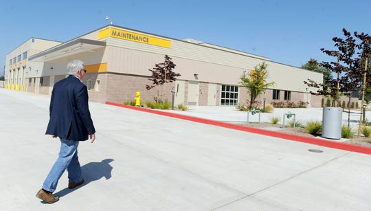Steve Brown, general manager of the Gold Coast Transit District, walks towards the service building of the district's  new headquarters at 1901 Auto Center Drive in Oxnard.