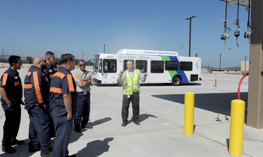 Jim Beck, fleet manager of the Gold Coast Transit District, gives some workers a tour of the district's new headquarters at 1901 Auto Center Drive in Oxnard.