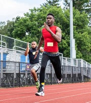Former Mount Saint Vincent runner Renaldo Phillip beats former Pearl River runner Alex Dowie (l) to the 100-meter dash finish during the 2019 Sunrise Day Camp fundraiser.