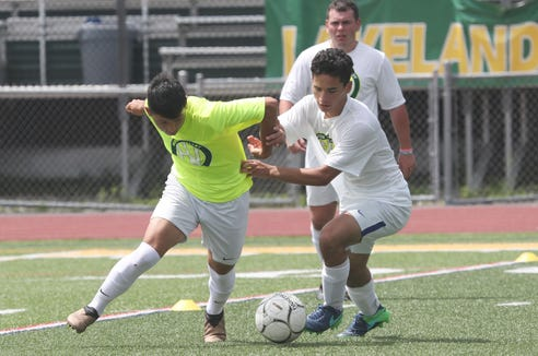 From left, Tuckahoe' Fabrico Lopez and Yorktown's Zakary Stanik battle for ball control during a scrimmage at the Hudson Valley College ID Soccer Camp at Lakeland High School in Shrub Oak July 19, 2019.