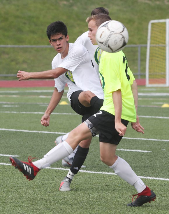 From left, Somers' Jose Giron kicks the ball away from Iona's Andre Cacerers during a scrimmage at the Hudson Valley College ID Soccer Camp at Lakeland High School in Shrub Oak July 19, 2019.