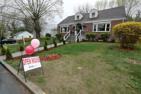 An open house at a home for sale on North Rd. in White Plains attracted several potential buyers on Easter Sunday April 21, 2019.