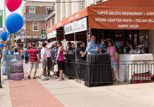 People gather at Caffe Gelato in downtown Newark.