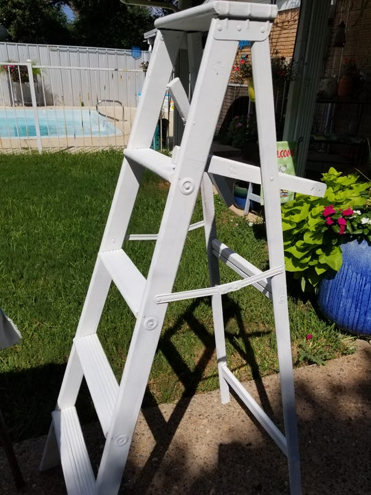 Step 1 in refurbishing an old ladder: Clean any dirt and debris from the ladder. Using your sandpaper, sand the ladder smooth, removing any rough edges or rust.