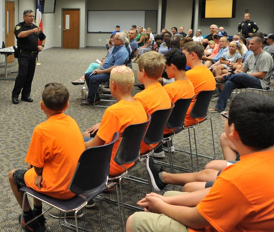 Wichita Falls Chief of Police Manuel Borrego chats with students Friday in the graduating 2019 Wichita Falls Junior Police Academy during a ceremony at the WFPD Training Center held to celebrate the classes achievement. Borrego thanked the students' parents and caregivers for allowing the students to participate in this year's academy.
