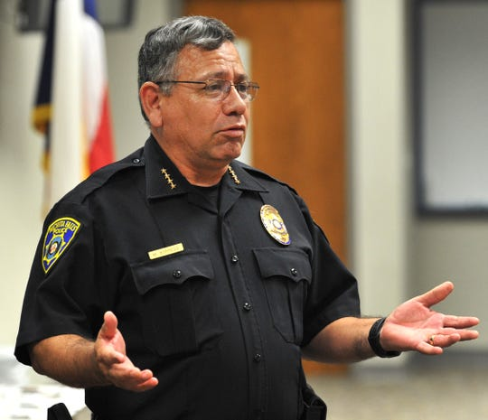 Wichita Falls Chief of Police Manuel Borrego chats with students Friday in the graduating 2019 Wichita Falls Junior Police Academy during a ceremony at the WFPD Training Center held to celebrate the classes achievement.