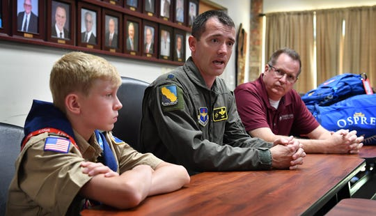Scout master Matt Simmons, center, talks about leading a group of about 80 North Texas scouts to the World Scout Jamboree in West Virginia. Joseph Brownfield, 14, and his father, Northwest Texas Council Scout Executive Greg Brownfield, will also be attending the event.