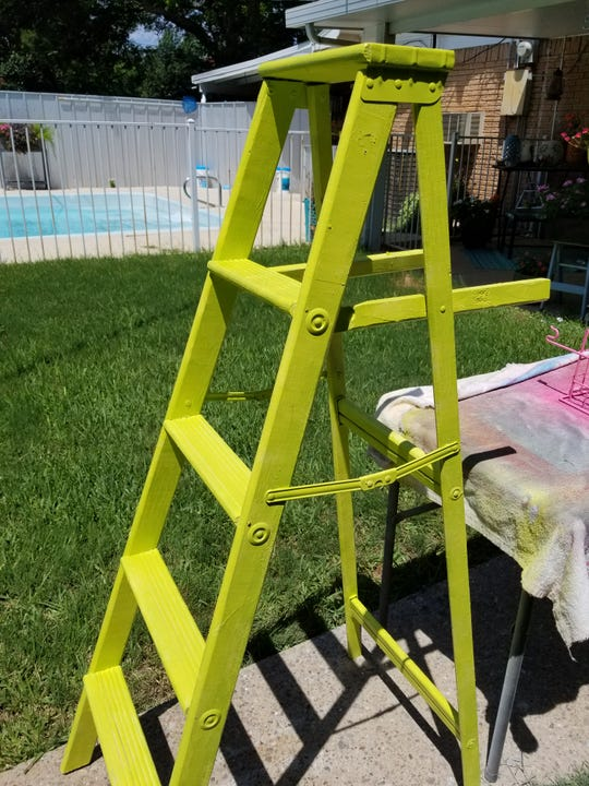 Step 2 in refurbishing an old ladder: Apply your paint color. Let dry completely.