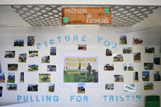 Tristin's 4-H group, Madison Junior Farmers, also dedicated their booth at the fair to Tristin.