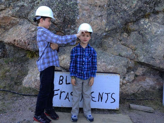 Aren and Iden Elliott at South Dakota Crazy Horse Memorial in 2012. Don't forget those hard hats, boys!