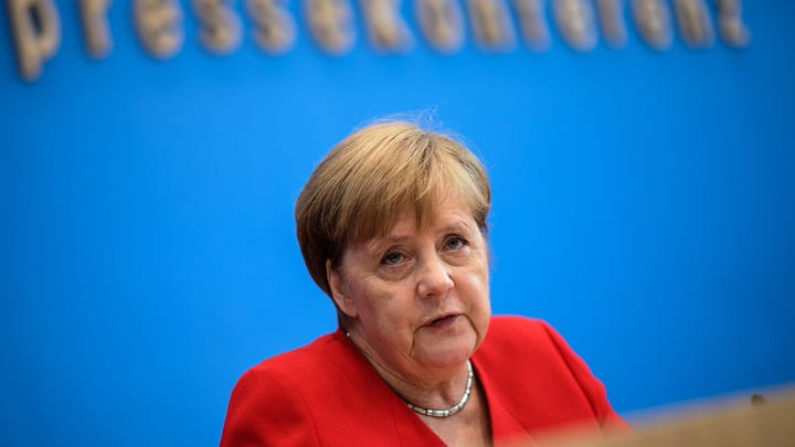 epa07726821 German Chancellor Angela Merkel gestures during her annual press conference at Bundespressekonferenz in Berlin, Germany, 19 July 2019. The traditional media briefing usually takes place during summer time.  EPA-EFE/CLEMENS BILAN