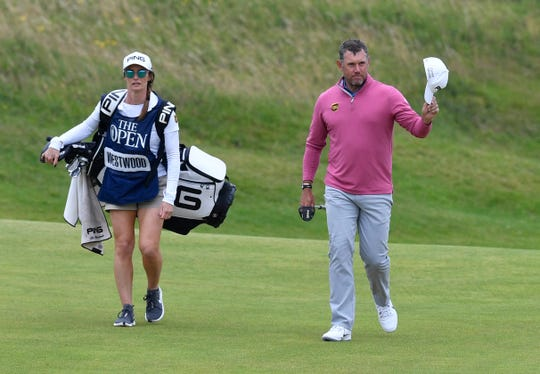 Lee Westwood and his caddie , girlfriend Helen Storey, walk to the 18th green during the second round of The British Open Championship.