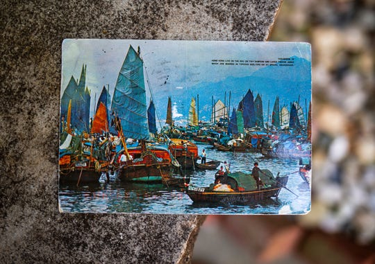 Kim Draper received a postcard, which depicts a scene of fishing boats in Hong Kong, at her home in Springfield on July 8, 2019 that was postmarked and sent from Hong Kong exactly 26 years ago on July 8, 1993 to a previous family that lived at her address.
