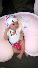 A picture of baby J'Aime Brown, who was born in St. Louis on 7-Eleven Day at 7:11 p.m. She weighed 7 pounds, 11 ounces.