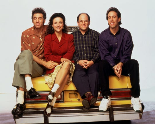 SEINFELD 100TH EPISODE -- Jerry Seinfeld stars in this Emmy-winning series (Outstanding Comedy Series, 1993) as a stand-up comedian whose life in New York City is made more chaotic by his quirky group of friends. (l to r) Michael Richards (Kramer), Julia Louis-Dreyfuss (Elaine), Jason Alexander (George), Jerry Seinfeld (Himself) Photographer: George Lange