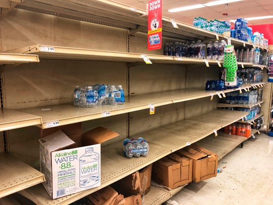 The shelves are nearly empty of water at the Winn Dixie in State Road 84 in Fort Lauderdale Thursday as people stock up on water due to a water main break.