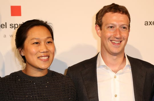 Mark Zuckerberg and Priscilla Chan arrive for the presentation of the first Axel Springer Award on February 25, 2016 in Berlin, Germany.