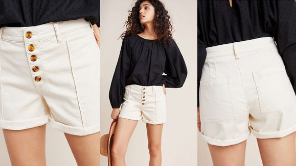 Stay cool in these ivory colored button-down shorts.