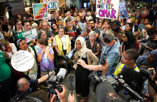 Rep. Ilhan Omar speaks to supporters after arriving home at Minneapolis–Saint Paul International Airport on Thursday, July 18, 2019, in Minnesota.