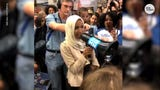 After landing back in Minnesota, Rep. Ilhan Omar was surrounded by supporters who welcomed her home.