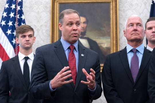 NASA Administrator Jim Bridenstine, center, speaks as President Donald Trump welcomes astronauts Buzz Aldrin, Michael Collins, and the family of Neil Armstrong to the Oval Office to honor the 50th anniversary of the Apollo moon landing at the White House in Washington, D.C., on Friday July 19, 2019.