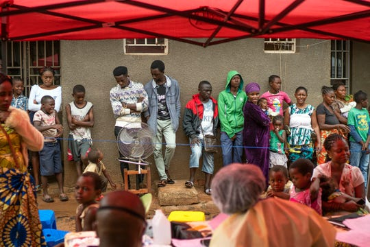 People line up to receive the vaccine for Ebola in Beni, Congo, on  July 13, 2019.