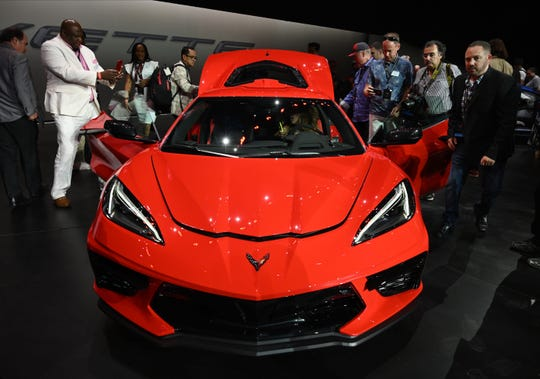 Photographers and audience members get a close look at the 2020 Chevrolet Corvette during an unveiling event held in an aircraft hanger in Tustin, Calif. July 19, 2019.